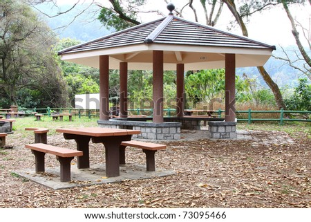 Chair and pavillion in country park of Hong Kong - stock photo
