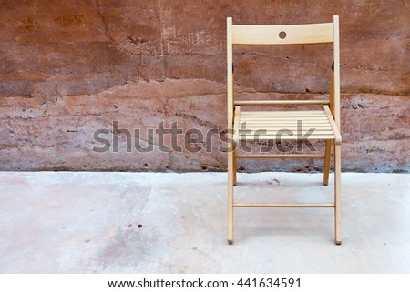 chair and stone wall