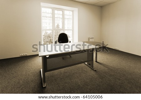 Chair and table at a window at modern office - stock photo