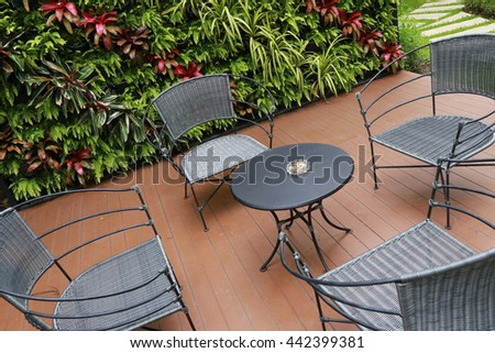 chair and table in garden - stock photo