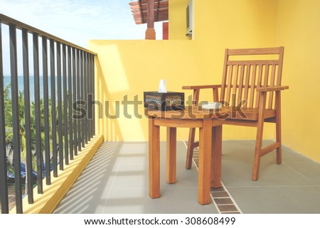 Chair and table on balcony of the resort, see view Bangsean sea, Soft filter - stock photo
