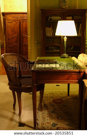 chair and the table with a lamp in retro style - stock photo