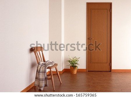 chair and vase near door - stock photo