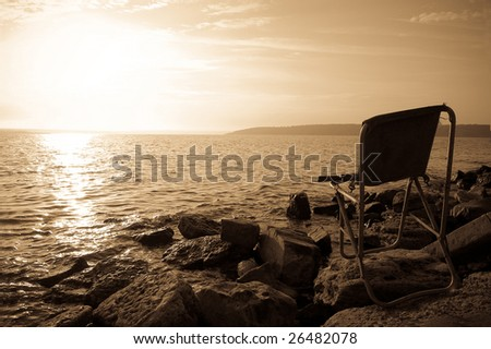 Chair at coast - stock photo