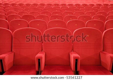 Chair #7. Empty cinema auditorium with lines of red chairs. - stock photo
