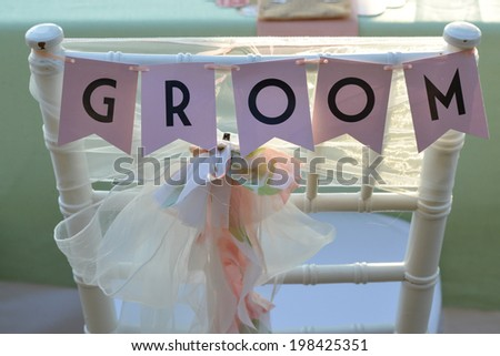 Chair for the groom at the wedding ceremony - stock photo