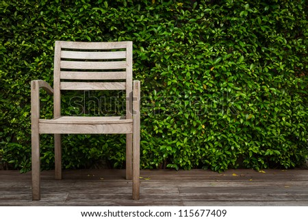 chair in a garden on wood floor - stock photo