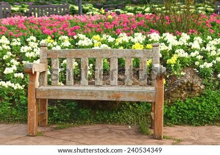 chair in flower garden  - stock photo