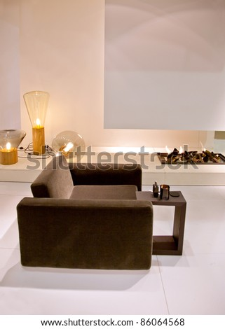 chair in living room with fire place - stock photo