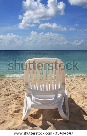 chair in the beach sand - stock photo