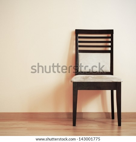 Chair in the corner of room - stock photo