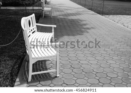 Chair  in the garden,black and white background
