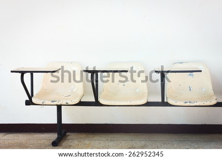 chair lecture in classroom - stock photo
