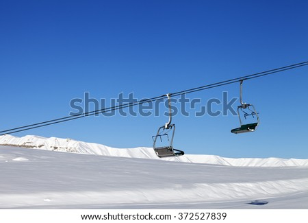 Chair-lift and blue clear sky at sun day. Greater Caucasus, Mount Shahdagh. Qusar rayon of Azerbaijan.
