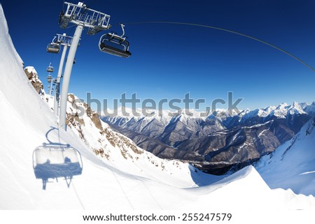 Chair lift ropeway panorama over mountain - stock photo