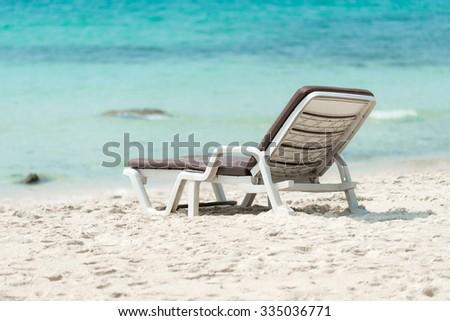 Chair on a beautiful beach - stock photo