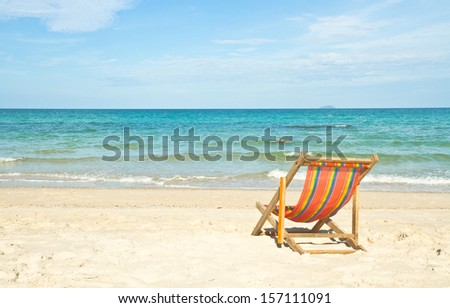 Chair on beach and blue sea in sunshine day
