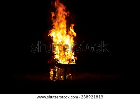 Charming Chair On Fire Burning In The Night Closeup