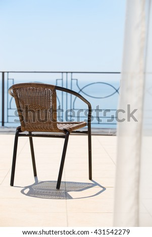 chair on terrace overlooking sea horizon