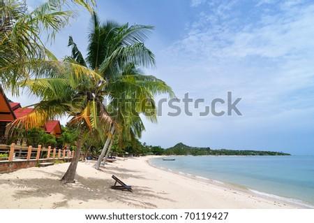 Chair on the beach of tropical sea - stock photo