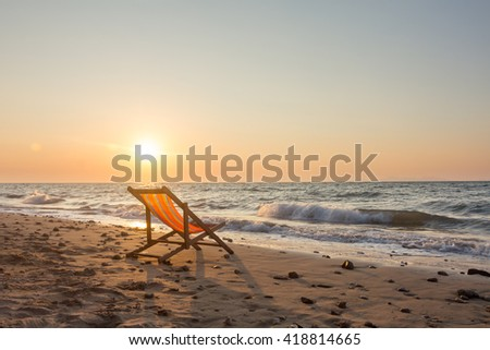 Chair on the beach with sunset