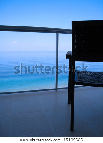 chair overlooking the beach - stock photo