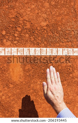 Chair Umpire check ball mark. Ball is IN. - stock photo