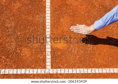 Chair Umpire look at ball mark. Ball touch line and he call it IN. - stock photo