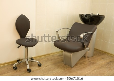 Chair-washing and chair barber in a barbershop. - stock photo