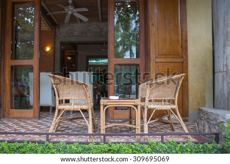 Chair with table in front of cafe shop