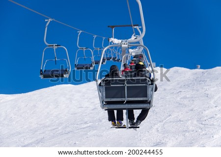 Chairlift at a ski slope - stock photo