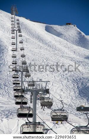Chairlift in a ski resort Krasnaya Polyana. Sochi, Russia - stock photo