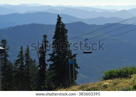 Chairlift on Mount Hood with mountains in the background. Oregon, USA Pacific Northwest. - stock photo