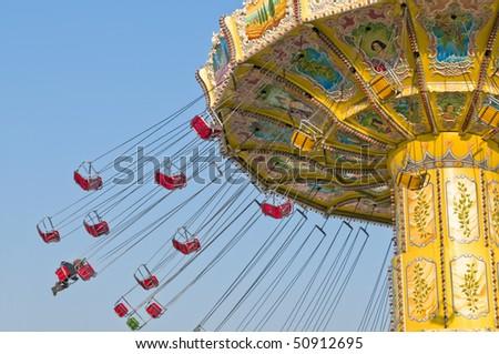 Chairoplane spinning on fun fair - stock photo
