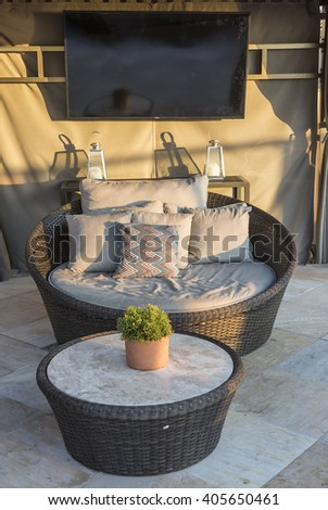 Chairs and a couch provide a place from a highrise rooftop - stock photo