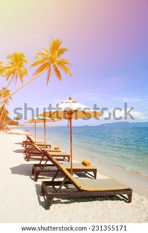 Chairs and an umbrella on the beach - stock photo
