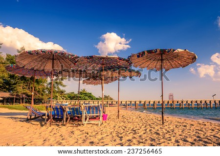Chairs and parasols on  sand beach, Rayong province, Thailand