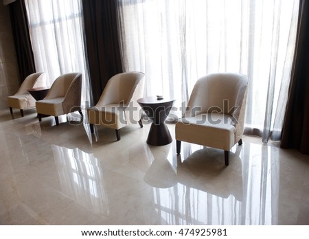 chairs and table close to a window for rest.