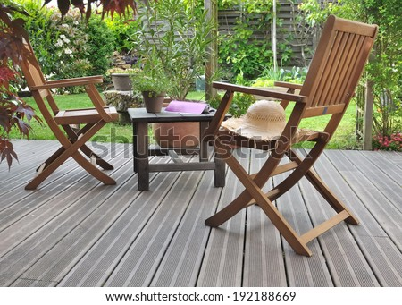 chairs and table in a wooden terrace  - stock photo