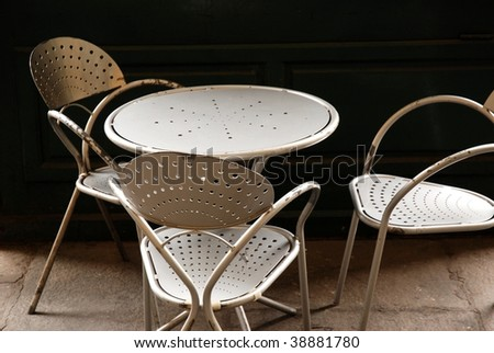 chairs and table in french cafe - stock photo