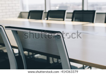 Chairs and table in the boardroom in office - stock photo