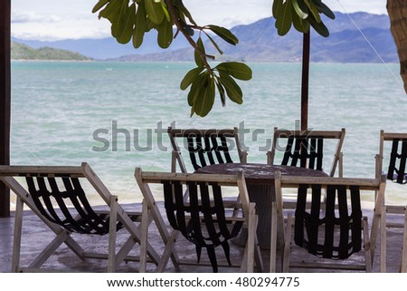 Chairs and table on the bank of the sea