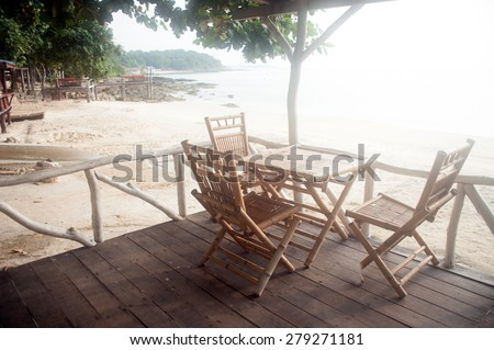 Chairs and table sitting under the eaves - stock photo