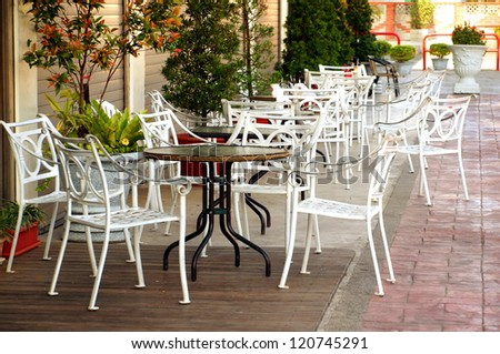 Chairs and tables at outdoor restaurant and cafe