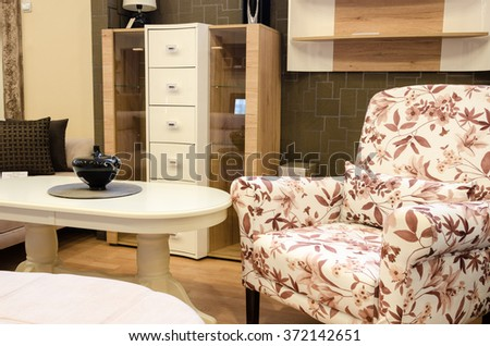 chairs and tables in the living room - stock photo