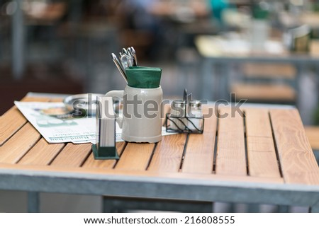 chairs and tables of a bar - stock photo
