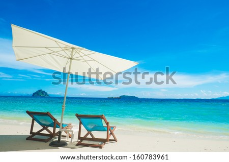 Chairs and Umbrella with Sea View at Phi Phi Island - stock photo