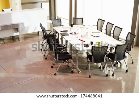Chairs Arranged Around Empty Boardroom Table - stock photo