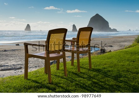 Chairs at Canon Beach, Oregon - stock photo