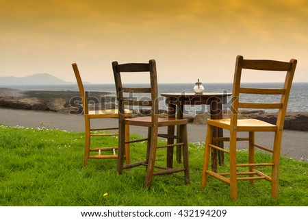 Chairs at the Atlantic ocean ( Ireland ) - stock photo